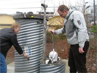 Interactive tour element, measuring the level of rainwater in a rain cathment system at Cascade People's Center pump at South Lake Union